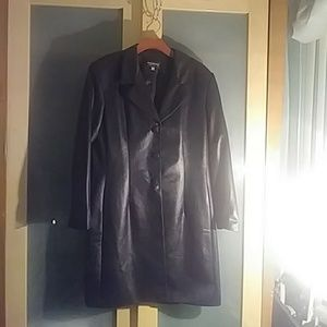 Black leather look trench coat.